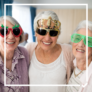 Group of three women wearing novelty glasses