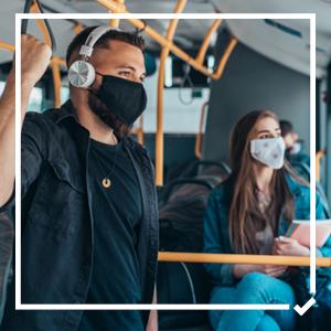 Passengers on a bus wearing masks