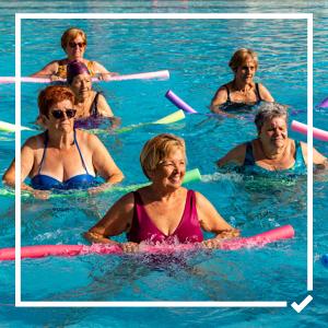 Women doing an aqua aerobics class in a swimming pool