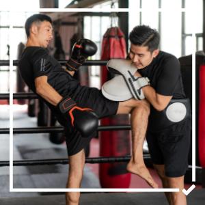 Two men practise kickboxing