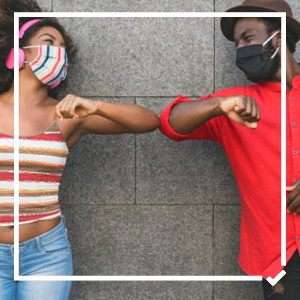 Man and woman bump elbows with masks on